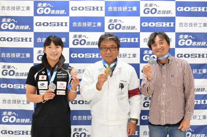 高久選手(左)と宮川コーチ(右)